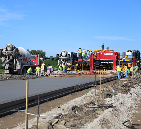 Crews paving NW Sunrise Drive in July 2020